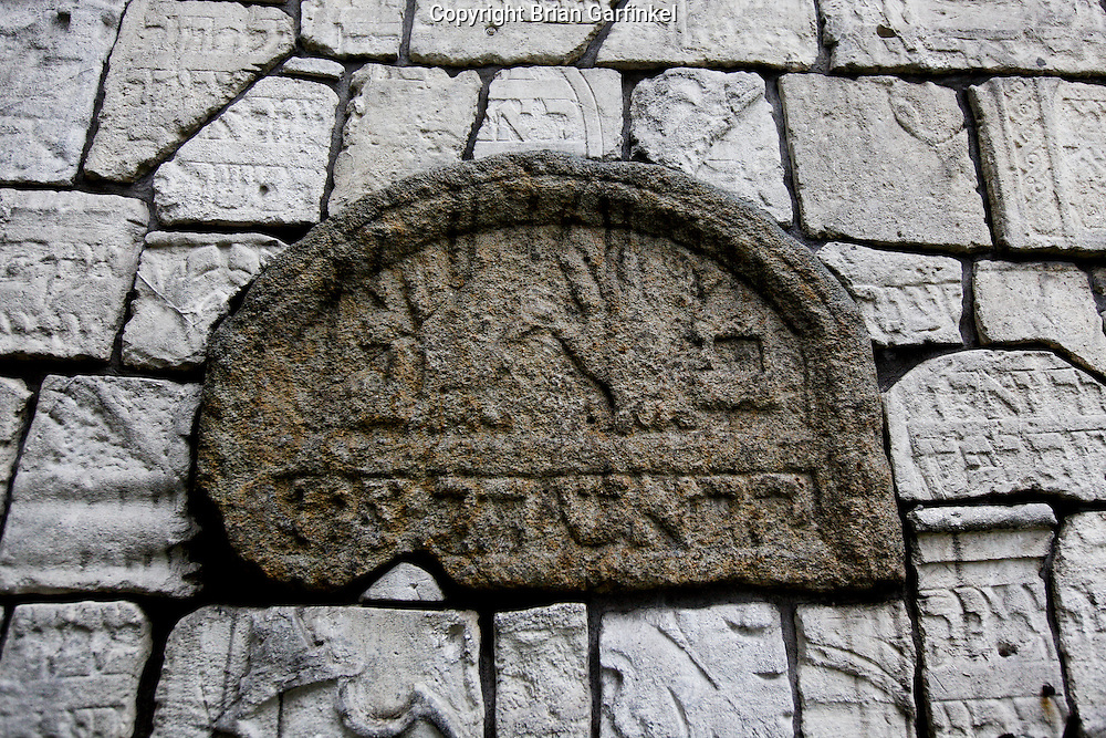 "A wall is made with old grave stones in the ""Old"" Jewish cemetery in Krakow, Poland on Monday July 4th 2011.  (Photo by Brian Garfinkel)"