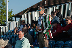 A Surbiton supporter at the Investec Women's Hockey League Finals Weekend, Sonning Lane, Reading, UK on 13 April 2014. Photo: Simon Parker