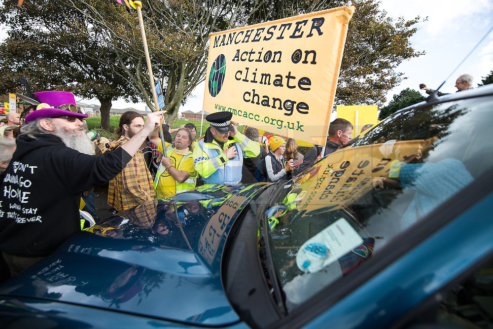 © Licensed to London News Pictures . 08/10/2016 . Lancashire , UK . Demonstrators block a vehicle from entering buildings on the farmland on Preston New Road on which the permission to frack has been granted . Anti fracking demonstration against the government and fracking firm Cuadrilla at Maple Farm on Preston New Road near Preston in Lancashire , following Communities and Local Government Minister Sajid Javid's decision to overturn Lancashire County Council's decision to ban fracking on the site . Photo credit : Joel Goodman/LNP