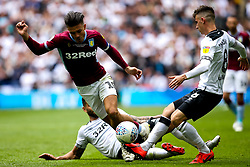 Jack Grealish of Aston Villa is tackled by Bradley Johnson of Derby County - Mandatory by-line: Robbie Stephenson/JMP - 27/05/2019 - FOOTBALL - Wembley Stadium - London, England - Aston Villa v Derby County - Sky Bet Championship Play-off Final