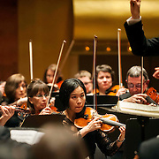 "March 11, 2013 - New York, NY : .Violinist Jeongmin Kim, center, and the London Philharmonic Orchestra, lead by conductor Vladimir Jurowski, top right, perform Gustav Mahler's Symphony No. 5 in C-sharp minor (1901-02), as part of Lincoln Center's ""Great Performers"" series at Avery Fisher Hall on Monday evening..CREDIT: Karsten Moran for The New York Times *This image is a crop variation.*"