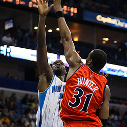 Mar 08, 2010; New Orleans, LA, USA;  New Orleans Hornets center Emeka Okafor (50) shoots over Golden State Warriors forward Chris Hunter (31) during the second half at the New Orleans Arena. Mandatory Credit: Derick E. Hingle-US PRESSWIRE