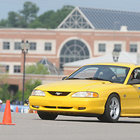 A driver competes in Disorderly Coneduct Autox at Blackwater Sunday July 27, 2014 on the North Campus of Cape Fear Community College in Castle Hayne, N.C. (Jason A. Frizzelle)