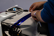 Crews applying decals in the BMW garage during round 6 of the Australian Superbike Championship on October 05, 2019 at Phillip Island Circuit, Victoria. (Image Dave Hewison/ Speed Media)