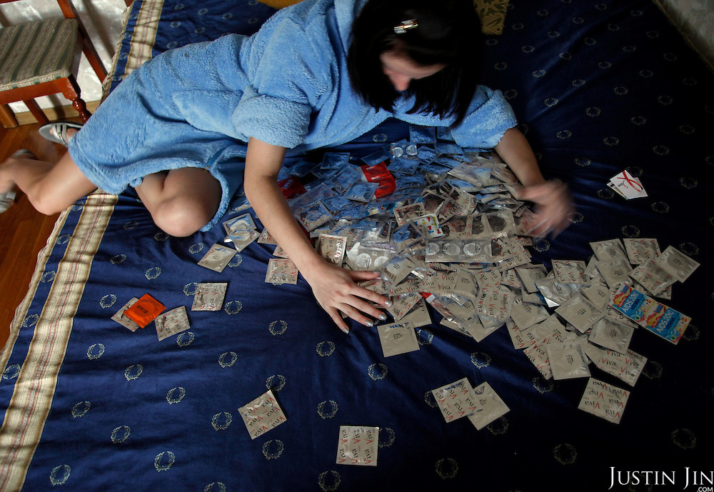 a sex workers gathers her condoms in St Petersburg.