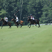 Competitors in action during the White Birch Vs K.I.G Polo match in the Butler Handicap Tournament match at the Greenwich Polo Club. White Birch won the game 11-8. Greenwich Polo Club,  Greenwich, Connecticut, USA. 12th July 2015. Photo Tim Clayton