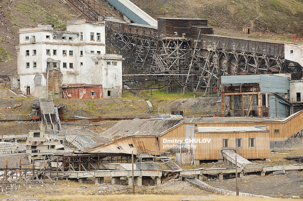 LONGYEARBYEN, NORWAY - SEPTEMBER 03, 2011: Exterior of the ruined coal mine in the abandoned Russian arctic settlement Pyramiden, Norway.