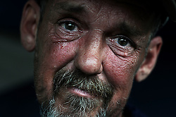 Alan Graves, 51, has lived on the edge of homelessness with low wages from part time jobs since 2011. When he lost his job at B.J. Bricker's restaurant in early summer he found himself homeless for the first time in his life sleeping in abandoned buildings, then in camps he cut from the woods near enough to Washington Street to maintain a job search that has remained fruitless.<br /> (Valley News - James M. Patterson)