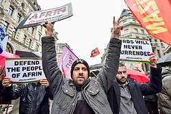 © Licensed to London News Pictures. 27/01/2018. LONDON, UK.  Protesters walk down Regent Street as thousands of Kurdish people march from the BBC's Headquarters in Portland Place to Downing Street to protest against Turkey's military invasion of the city of Afrin in Northern Syria, a predominantly Kurdish city.  Protesters called for the British public to show solidarity with the people of Afrin and for the UK to demand that Turkey pull back its forces.  Photo credit: Stephen Chung/LNP