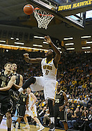 February 27 2013: Iowa Hawkeyes center Gabriel Olaseni (0) watches the ball after being fouled by Purdue Boilermakers forward Donnie Hale (15) during the first half of the NCAA basketball game between the Purdue Boilermakers and the Iowa Hawkeyes at Carver-Hawkeye Arena in Iowa City, Iowa on Wednesday, February 27 2013.