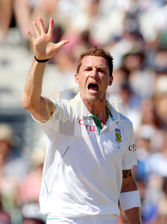 South Africa's Dale Steyn screams 'five' and holds up 5 fingers as he claims his fifth wicket - England's Graeme Swann out for 7 caught Alviro Petersen - England v South Africa - 1st Investec Test Match -  Day 5 - The Oval  - London - 23/07/2012..Andrew Fosker / Seconds Left Images