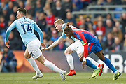 Manchester City defender Aymeric Laporte (14), Manchester City midfielder Kevin De Bruyne (17) and Crystal Palace forward Wilfried Zaha (11) during the Premier League match between Crystal Palace and Manchester City at Selhurst Park, London, England on 14 April 2019.