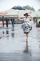 31/07/2013 Orlagh Winters from Tralee Co. Kerry  braved the elements the third day of the Galway Races  .   Picture:Andrew Downes