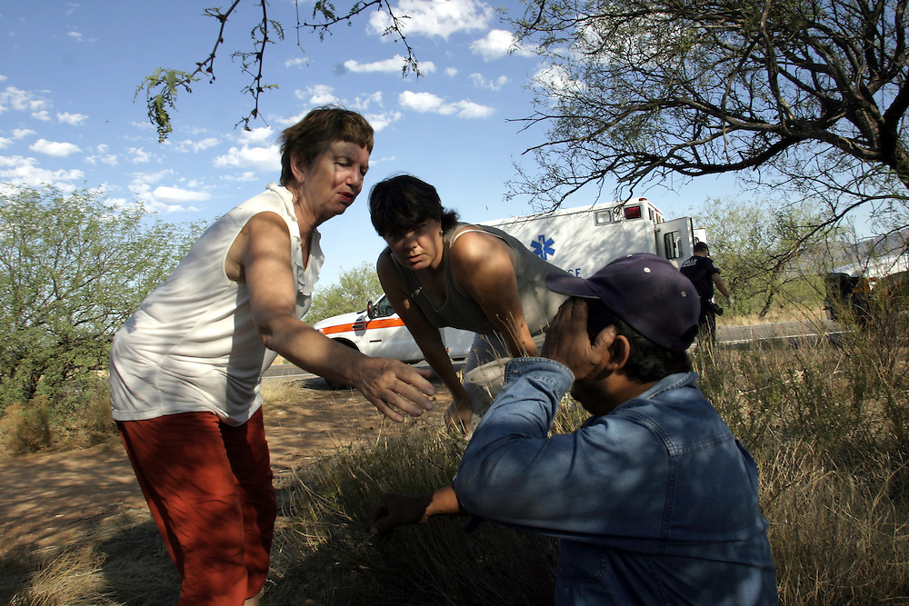 Doug Ruopp, 52, and Susan, volunteers with the Tucson-based Samaritans humanitarian group, help Migual Estrada, 42, an undocumented immigrant found 50 meters from the main road into Arizona from the Mexican border on July 12 2006. After four days of walking alone in the desert without water, Estrada was taken to a local hospital.