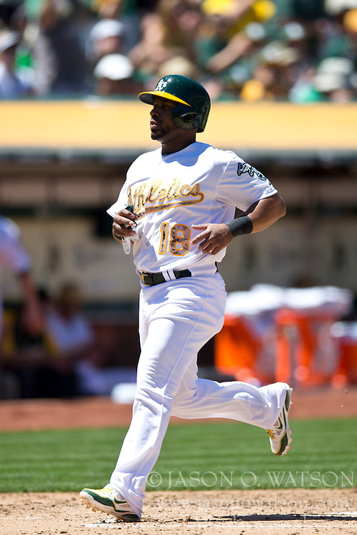 OAKLAND, CA - MAY 26:  Alberto Callaspo #18 of the Oakland Athletics scores a run after tagging up on a sacrifice fly hit off the bat of Coco Crisp #4 (not pictured) during the fourth inning against the Detroit Tigers at O.co Coliseum on May 26, 2014 in Oakland, California. The Oakland Athletics defeated the Detroit Tigers 10-0.  (Photo by Jason O. Watson/Getty Images) *** Local Caption *** Alberto Callaspo