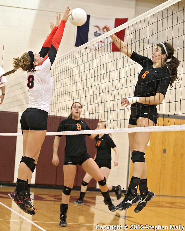 Maquoketa's Aubree Taylor (8) tries to block a shot by Solon's Kelsey Cave (6) during the WaMaC Tournament Championship game at Mount Vernon High School in Mount Vernon on Thursday October 11, 2012. Solon defeated Maquoketa 17-25, 25-15, 15-10.