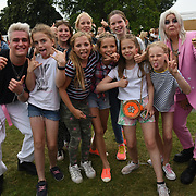 Young fans having a selfies with Dusky Grey performs at Kew the Music 2019 on 10 July 2019, London, UK.
