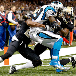 Dec 8, 2013; New Orleans, LA, USA; Carolina Panthers wide receiver Steve Smith (89) catches a touchdown past New Orleans Saints cornerback Keenan Lewis (28) and free safety Malcolm Jenkins (27) during the fourth quarter of a game at Mercedes-Benz Superdome. The Saints defeated the Panthers 31-13. Mandatory Credit: Derick E. Hingle-USA TODAY Sports