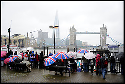 Royal Fans wait to watch the Royal Pageant at Tower Bridge during the Queen's Diamond Jubilee weekend, Sunday June 3, 2012. Photo By Andrew Parsons/i-Images