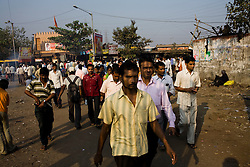People walk towards the Mankhurd train station in Mumbai, a city of over 13 million.  Overcrowding is a risk factor in urban areas, making it easier for the TB bacteria, which is very contagious, to be passed from person to person.