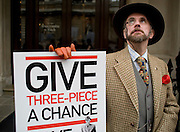 "Picture by Mark Larner. Picture shows Torquil Arbuthnot, Chairman of the New Sheridan Club. Chaps gathered outside Abercrombie & Fitch's London store to protest against the proposed opening of an A&F store on Savile Row, the centuries old home of bespoke tailoring. 23/04/2012..Press release from The Chap Magazine:-.""On Monday, 23rd April 2012 (St Georges Day) several hundred immaculately dressed Chaps and Chapettes will gather outside number 3, Savile Row, to protest in the strongest possible terms against the opening of a childrens clothes shop there by Abercrombie & Fitch.The Chap feels that this city is already overwhelmed with American-style chain stores selling overpriced T-shirts and hooded sporting garments for those who rarely do any sport. Savile Row has been the home of gentlemens bespoke tailoring for over 200 years, and the opening of this store would signal the end of this one little street being allowed to devote itself to a single trade.""."