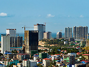 "15 FEBRUARY 2019 - SIHANOUKVILLE, CAMBODIA:  Construction sites for Chinese resorts and casinos rise over downtown Sihanoukville. There are about 80 Chinese casinos and resort hotels open in Sihanoukville and dozens more under construction. The casinos are changing the city, once a sleepy port on Southeast Asia's ""backpacker trail"" into a booming city. The change is coming with a cost though. Many Cambodian residents of Sihanoukville  have lost their homes to make way for the casinos and the jobs are going to Chinese workers, brought in to build casinos and work in the casinos.    PHOTO BY JACK KURTZ"