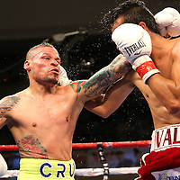 KISSIMMEE, FL - JULY 15: Alejandro Valdez (R) lands a right to the head of Orlando Cruz during a boxing match at the Kissimmee Civic Center on July 15, 2016 in Kissimmee, Florida. Cruz was the first professional boxer to announce himself as gay and recently lost four friends in the Pulse Nightclub shooting in Orlando, he dedicated this match to his lost friends and won the bout by TKO in the 7th round.  (Photo by Alex Menendez/Getty Images) *** Local Caption *** Orlando Cruz; Alejandro Valdez