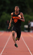 Xavier Mascareñas/The Journal News; Winslow Dorsainvil of Spring Valley wins first place in the 100-meter dash during the Rockland County boys and girls track and field championships at Suffern Middle School on May 18, 2012.