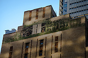 May 5, 2014 - New York, NY. Sign atop 219 W. 40th advertised building's original owner, the New York Herald Tribune (see H-e-r-a at left in white on green), before another sign was painted over it. 05/05/2014 Photograph by Kevin R. Convey/NYCity Photo Wire.