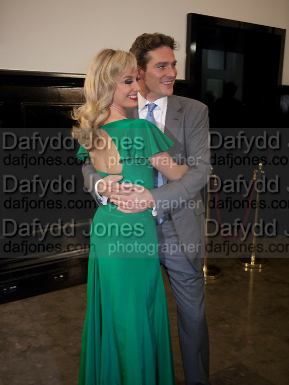 TAMZIN OUTHWAITE; MARK UMBERS, PARTY AFTER THE OPENING OF SWEET CHARITY.  National Portrait Gallery cafe. London. 4 May 2010.  *** Local Caption *** -DO NOT ARCHIVE-&copy; Copyright Photograph by Dafydd Jones. 248 Clapham Rd. London SW9 0PZ. Tel 0207 820 0771. www.dafjones.com.<br /> TAMZIN OUTHWAITE; MARK UMBERS, PARTY AFTER THE OPENING OF SWEET CHARITY.  National Portrait Gallery cafe. London. 4 May 2010.