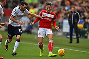 Josh Brownhill (8) of Bristol City on the attack battles for possession with Will Buckley (11) of Bolton Wanderers during the EFL Sky Bet Championship match between Bristol City and Bolton Wanderers at Ashton Gate, Bristol, England on 12 January 2019.