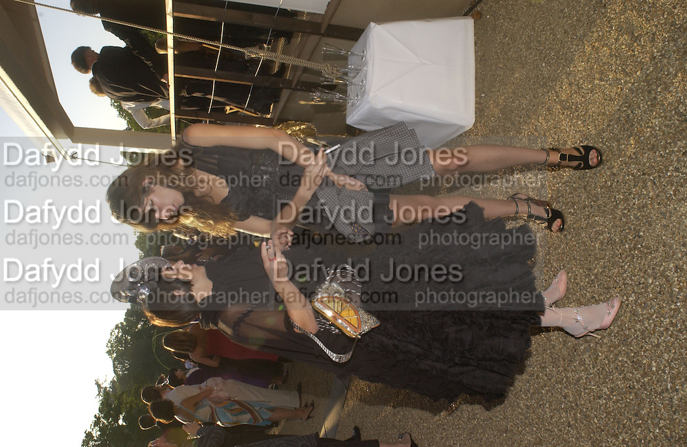 Isabella Blow and Lou Doillon, Louis Vuitton classic and celebration of their 150 anniversary. Waddesdon Manor, June 4 2004. ONE TIME USE ONLY - DO NOT ARCHIVE  © Copyright Photograph by Dafydd Jones 66 Stockwell Park Rd. London SW9 0DA Tel 020 7733 0108 www.dafjones.com