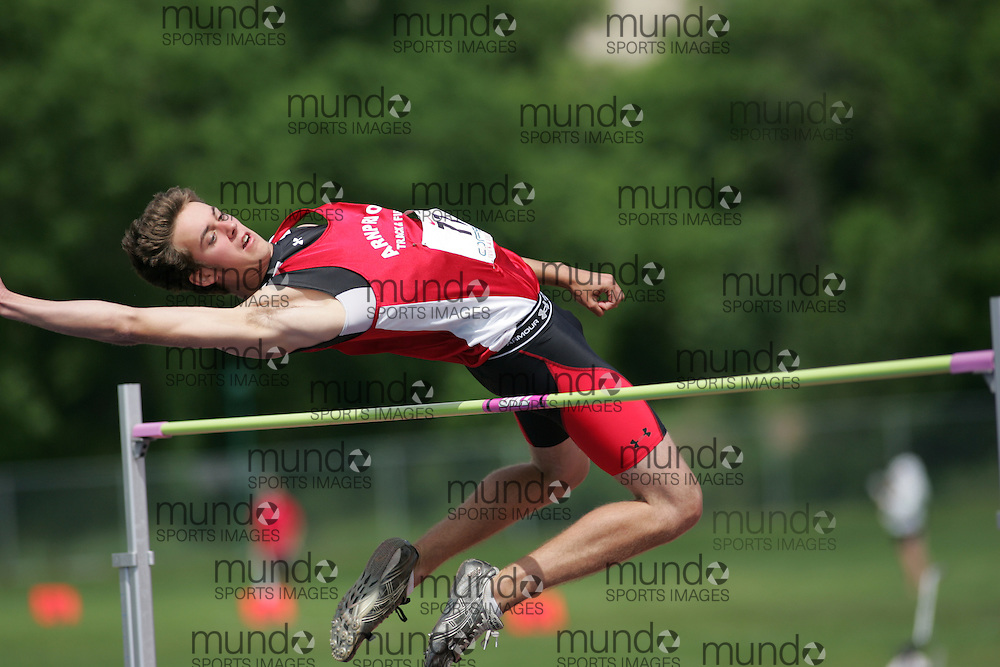 (London, Ontario}---04 June 2010) Cody Moore of Arnprior - Arnprior competing in the high jump at the 2010 OFSAA Ontario High School Track and Field Championships. Photograph copyright Sean Burges / Mundo Sport Images, 2010.