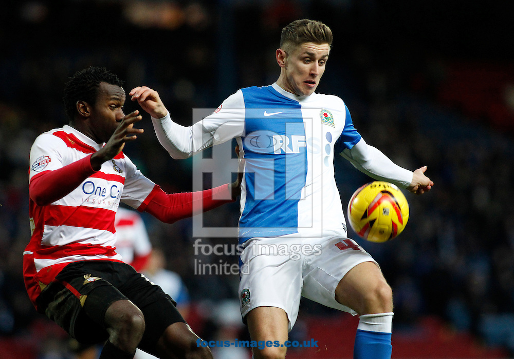 Picture by Michael Sedgwick/Focus Images Ltd +44 7900 363072<br /> 11/01/2014<br /> Matthew Kilgallon of Blackburn Rovers and Bongani Khumalo of Doncaster Rovers in action during the Sky Bet Championship match at Ewood Park, Blackburn.