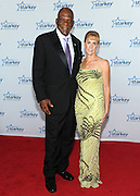 "Former NFL player Carl Eller and guest is seen on the red carpet at the Starkey Hearing Foundation's ""So the World May Hear"" Awards Gala on Sunday, July 20, 2014 in St. Paul, Minn. (Photo by Diane Bondareff/Invision for Starkey Hearing Foundation/AP Images)"