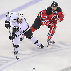 May 30, 2012: Los Angeles Kings defenseman Willie Mitchell (33) skates the puck away from New Jersey Devils left wing Ilya Kovalchuk (17) during first period action in game 1 of the NHL Stanley Cup Final between the New Jersey Devils and the Los Angeles Kings at the Prudential Center in Newark, N.J.
