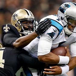 Dec 8, 2013; New Orleans, LA, USA; New Orleans Saints outside linebacker Junior Galette (93) and defensive end Cameron Jordan (94) tackle Carolina Panthers quarterback Cam Newton (1) for a sack during the first quarter of a game at Mercedes-Benz Superdome. Mandatory Credit: Derick E. Hingle-USA TODAY Sports