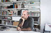 """SOVERIA MANNELLI, ITALY - 17 NOVEMBER 2016: Emilio Salvatore Leo (41), entrepreneur and heir of the woolen mill and historic family business Lanificio Leo, is seen here during an interview in his office in Soveria Mannelli, Italy, on November 17th 2016.<br /> <br /> Lanificio Leo was the first and last machine-operated woolen mill of Calabria, founded in 1873, it employed 50 people until the 1970s, when national policies to develop Italy's South cut out small businesses and encouraged larger productions or employment in the public administration.<br /> <br /> The woolen mill was on stand-by for about two decades, until Emilio Salvatore Leo, 41, started inviting international designers and artists to summer residencies in Soveria Mannelli. With their inspiration, he tried to envision a future for his mill and his town that was not of a museum of the past,<br /> Over the years, Mr. Leo transformed his family's industrial converter of Calabrian wool into a brand that makes design products for home and wear. His century old machines now weave wool from Australia or New Zealand, cashmere from Nepal and cotton from Egypt or South America. He calls it a """"start-up on scrap metals,"""" referring to the dozens of different looms that his family acquired over the years.<br /> <br /> Soveria Mannelli is a mountain-top village in the southern region of Calabria that counts 3,070 inhabitants. The town was a strategic outpost until the 1970s, when the main artery road from Naples area to Italy's south-western tip, Reggio Calabria went through the town. But once the government started building a motorway miles away, it was cut out from the fastest communications and from the most ambitious plans to develop Italy's South. Instead of despairing, residents benefited of the geographical disadvantage to keep away the mafia infiltrations, and started creating solid businesses thanks to its administrative stability, its forward-thinking mayors and a vibrant entrepreneurship numbering a natio"""