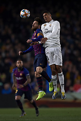 February 6, 2019 - Barcelona, Barcelona, Spain - Lionel Messi of Barcelona and Raphael Varane of Real Madrid competes for the ball during the Spanish Cup (King's cup), first leg semi-final match between FC Barcelona and  Real Madrid at Camp Nou stadium on February 6, 2019 in Barcelona, Spain. (Credit Image: © Jose Breton/NurPhoto via ZUMA Press)