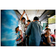 Straphangers on a bus in New Dehli. The 2007 arrival of the Tata Nano, a modestly outfitted car with a price tag of 100.000 rupies (appr. USD 1500,-) made it affordable for many Indians. Car ownership in India has doubled every 8-10 years, according to World Resources Institute, and it is hurting the country. A WHO study from 2014 found that 13 of the world's  20 most polluted cities are in India. While government is focused on upgrading the road system, some businesses are encouraging their emplyees to use public transportation instead. Subsidies for car-pooling or public transportation and designated company buses are among innovative solutions to make the commute easier. Given these options, 30-50 percent of the workers switched from cars to public transit, which also reduced their travel time and cost of commuting. The third largest emitter of CO2, India has historically resisted any responsibility for their CO2 contribution. Their argument was that the emissions were low per capita as well as historical. According to an article in Clean Technica August 13th 2015, that stand could be about to change. Their findings indicate that India is looking to actively reduce emissions  and advocate carbon tax to be adopted by the G7 countries.