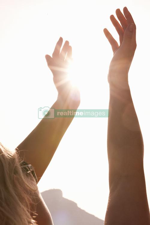 Jun. 16, 2009 - Woman Holding Arms Up To Sun. Model Released (MR) (Credit Image: © Cultura/ZUMAPRESS.com)