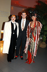 Left to right, MRS LOUISE MAZZILLI, MR ROCKY MAZZILLI  and MISS TATUM MAZZILLI of the Voyage fashion store at Andy & Patti Wong's Chinese New Year party to celebrate the year of the Rooster held at the Great Eastern Hotel, Liverpool Street, London on 29th January 2005.  Guests were invited to dress in 1920's Shanghai fashion.<br />