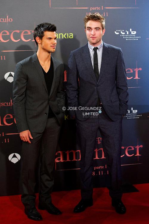 US Actor Taylor Lautner and US Actor Robert Pattinson attend the Spain premiere of The Twilight Saga: Breaking Dawn Part 1 at Forum del Centro de Convenciones Internacional in Barcelona, Spain