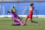 Brighton's keeper Faye Baker clears a Charlton attack during the FA Women's Premier League Cup quarter-final match between Brighton Ladies and Charlton Athletic WFC at The American Express Elite Football Performance Centre, Lancing, United Kingdom on 1 March 2015. Photo by Geoff Penn.
