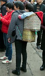 Woven baby carrier, street scene, Ciqikou Old Town, <br /> Chongqing, China.