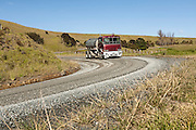 water tanker on dirt road New Zealand