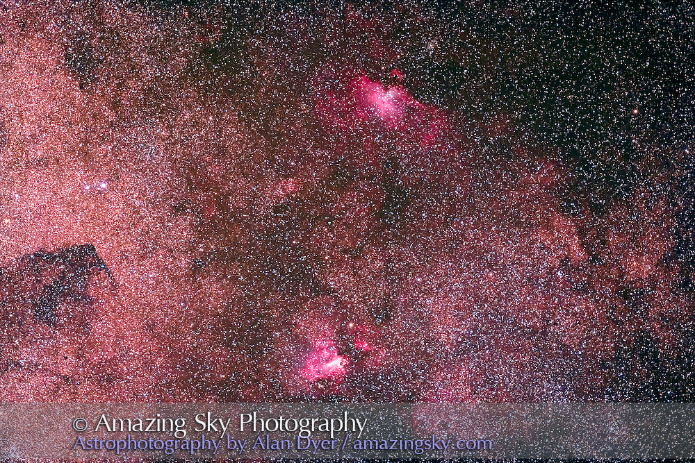 M16 and M17 Nebulas, taken with 77mm Borg astrogrpahic refractor at f/4.3 and Hutech-modified Canon 5D camera for stack of 4 x 10 minute exposures at ISO 400. Taken from Coonabarabran, NSW, Australia, April 17, 2007. Scope aimed straight up and so mount wandering somewhat with guiding errors. Focus slightly soft from temperature change thru the night (this was taken at the end of the night).