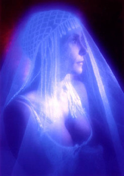 Pretty woman with glowing headpiece.Black light