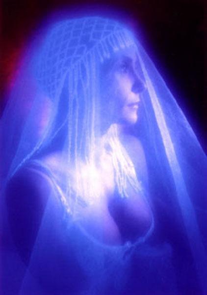 Pretty woman with glowing headpiece.Black light