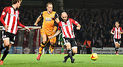 Alan McCormack plays a through ball  during the Sky Bet Championship match between Brentford and Hull City at Griffin Park, London, England on 3 November 2015. Photo by Michael Hulf.